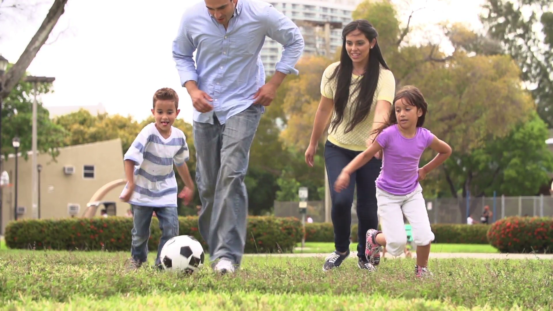 slow-motion-shot-of-hispanic-family-playing-soccer-together_vy1kofc__F0000